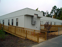 Modular buildings with wheelchair ramps.
