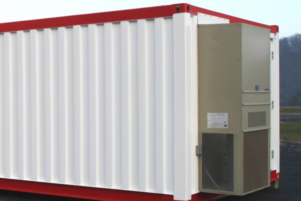 End of modular building with air conditioning unit.